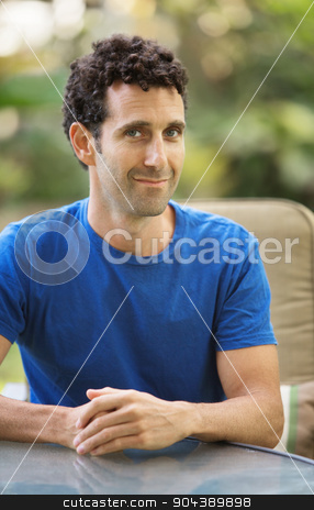 Grinning Adult Male stock photo, Grinning adult in blue shirt with grin by Scott Griessel