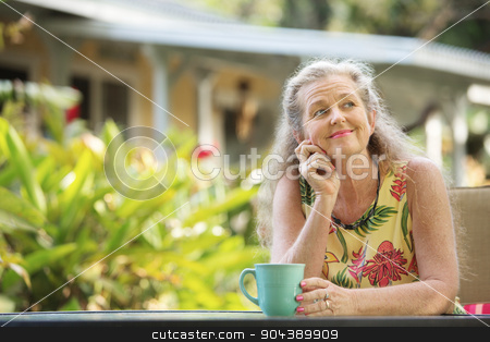 Cute Mature Female Wondering stock photo, Cute single mature woman with hand on chin by Scott Griessel