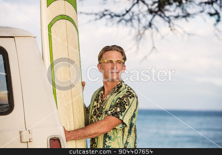 Optimistic Man with Surfboard stock photo, Optimistic man with eyeglasses holding a surfboard in Hawaii by Scott Griessel