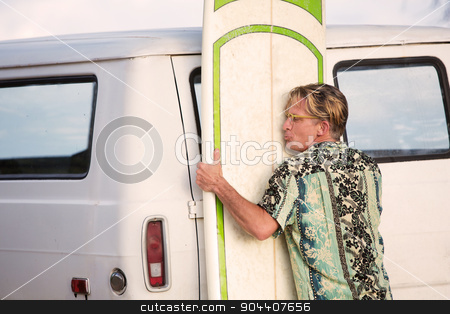 Man Lifting Heavy Surfboard stock photo, One middle aged man lifting heavy surfboard by Scott Griessel