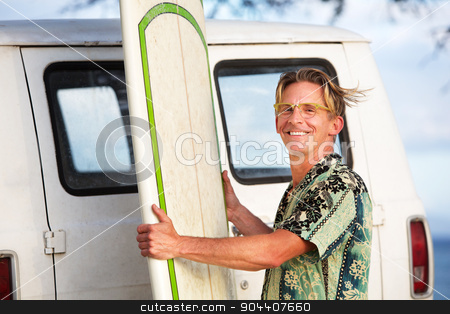 Wind Blowing On Surfer stock photo, Handsome man with surfboard and wind blowing his hair by Scott Griessel