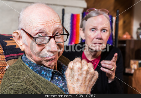 Tough Elderly Couple stock photo, Tough elderly couple indoors with aggressive gesturing by Scott Griessel