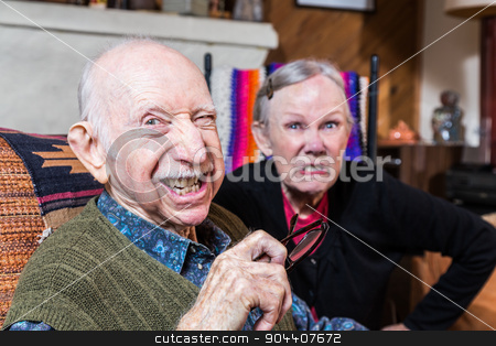 Angry Old Couple stock photo, Angry old couple sitting indoors with scowling expression  by Scott Griessel