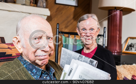 Elderly Husband and Wife with Newspaper stock photo, Cute elderly husband and wife reading newspapers by Scott Griessel