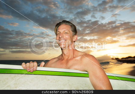 Surfing at Sunset stock photo, One adult Caucasian surfer with surfboard at sunset by Scott Griessel