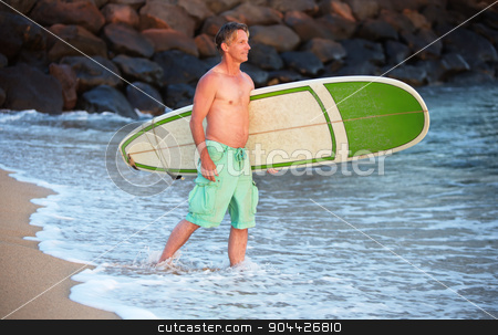 Surfer Walking Into Water stock photo, Single surfer walking into ocean water with surfboard by Scott Griessel