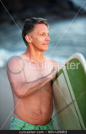 Confident Man with Green Surfboard stock photo, Confident middle aged surfer with surfboard looking over by Scott Griessel