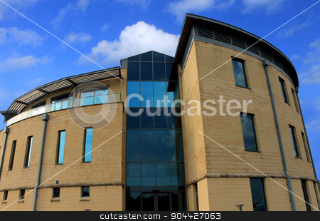 Exterior of a new modern office building stock photo, Exterior of a new modern office building with blue sky and clouds. by Martin Crowdy
