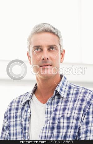 Casual businessman looking away