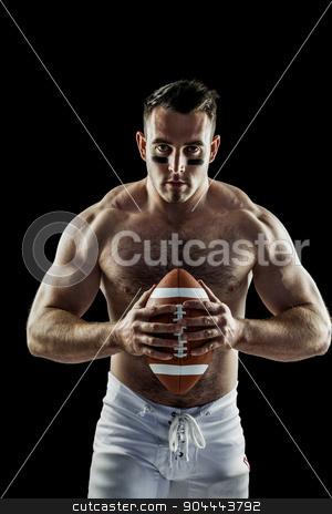 Shirtless American football player with ball