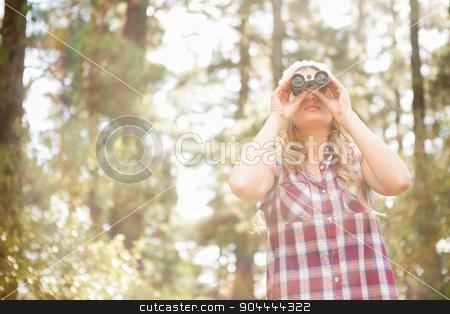 Pretty young blonde looking through binoculars