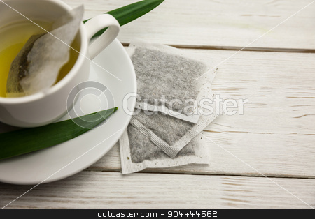 Cup of herbal tea on table