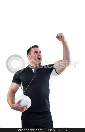 Rugby player cheering with the ball