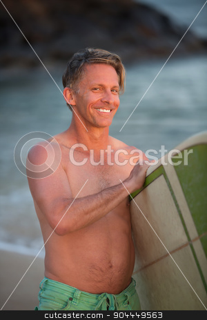 Cute Man with Surfboard stock photo, Smiling single adult Caucasian male at beach with surfboard by Scott Griessel