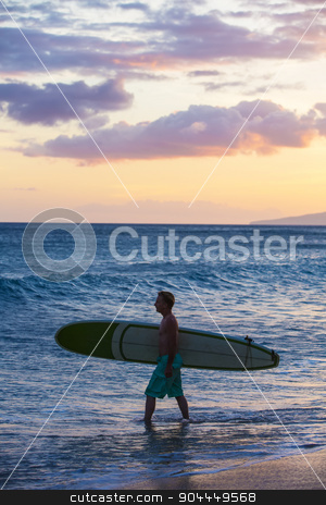 Single Man Outdoors stock photo, Single surfer carrying his surfboard into the ocean by Scott Griessel