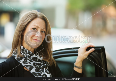 Business Woman Standing Near Car stock photo, Gorgeous adult business woman standing at car door by Scott Griessel