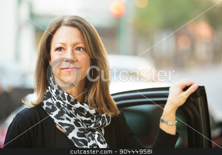 Confident Woman Near Car stock photo, Confident European business woman standing near car door by Scott Griessel