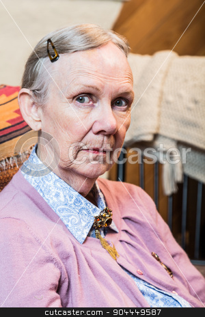 Old Woman Seated stock photo, Retro style old woman seated and looking at camera by Scott Griessel