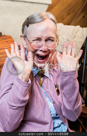 Happy Old Woman stock photo, Happy old woman with a hands up gesture by Scott Griessel