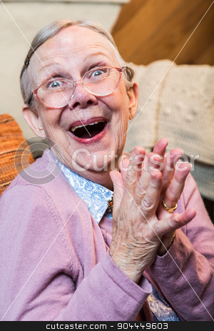 Joyful Old Woman stock photo, Joyful old woman in pink sweater with hands together by Scott Griessel