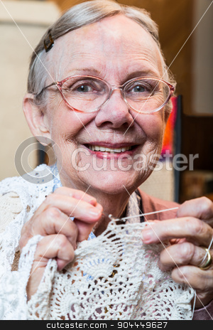 Smiling Old Woman with Crochet stock photo, Smiling old woman with crochet looking at camera by Scott Griessel