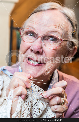 Crazy Old Lady with Crochet stock photo, Crazy old lady with crochet and odd expression by Scott Griessel