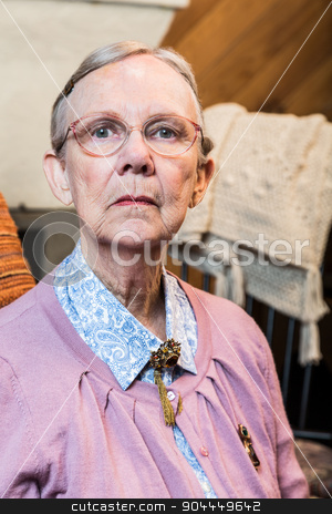 Old Woman Sitting Sternly stock photo, Old woman in pink sweater sitting straight and stern by Scott Griessel