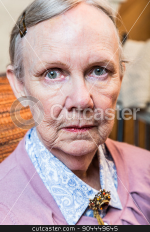Serious Old Lady stock photo, Serious old lady looks harshly at camera by Scott Griessel