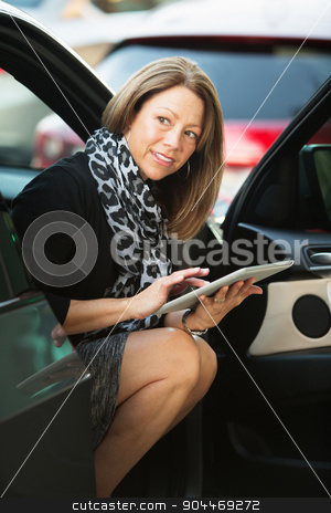 Woman Working From Car stock photo, Business woman working out of her car on tablet computer by Scott Griessel