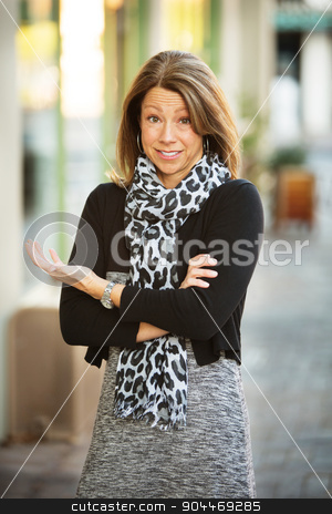 Perplexed Businesswoman stock photo, Perplexed businesswoman with folded arms standing in urban scene by Scott Griessel