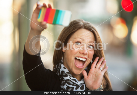 Beautiful Woman Waving at Her Phone stock photo, Beautiful single Caucasian woman outdoors waving at her camera by Scott Griessel