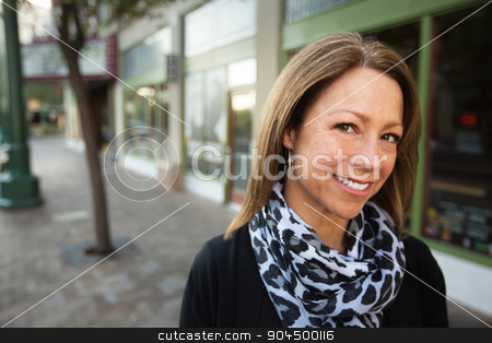 Cheerful Business Owner stock photo, Mature female business owner standing in front of store by Scott Griessel