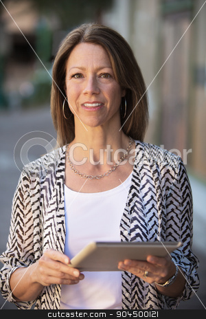 Confident Woman Holding Tablet stock photo, Beautiful confident business woman holding a tablet computer by Scott Griessel