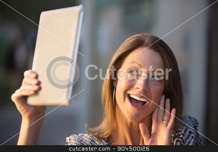 Lady Waving at Tablet Computer stock photo, Beautiful single Caucasian woman waving at her tablet computer by Scott Griessel