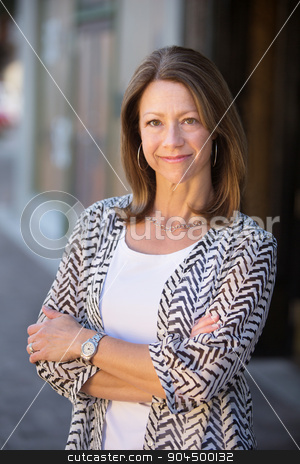 Confident Lady Standing stock photo, Beautiful confident single Caucasian woman with folded arms by Scott Griessel