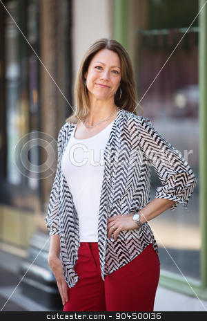 Woman with Glad Expression stock photo, Beautiful single woman outdoors with a glad expression by Scott Griessel