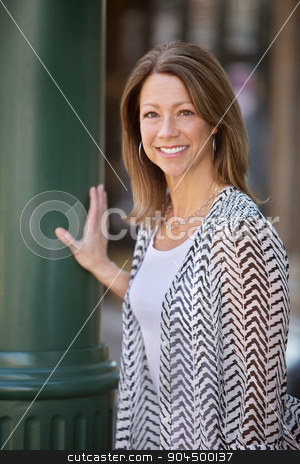Cute Woman in Urban Scene stock photo, Cute single adult female in an urban scene by Scott Griessel