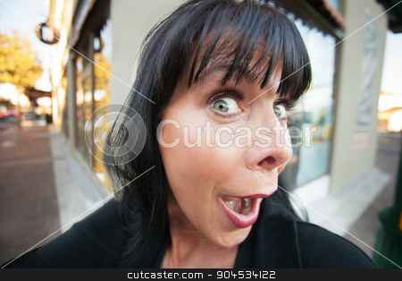 Female Takes a Selfie stock photo, Woman takes an early morning selfie on downtown street by Scott Griessel