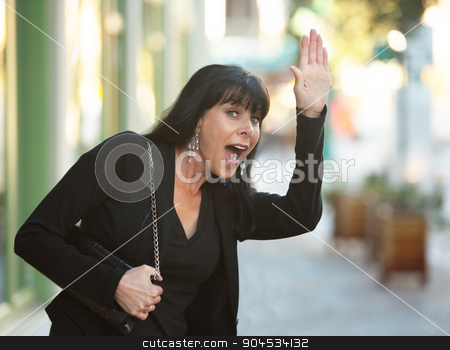 Waving on a Downtown Street stock photo, Beautiful woman on a downtown street waving by Scott Griessel