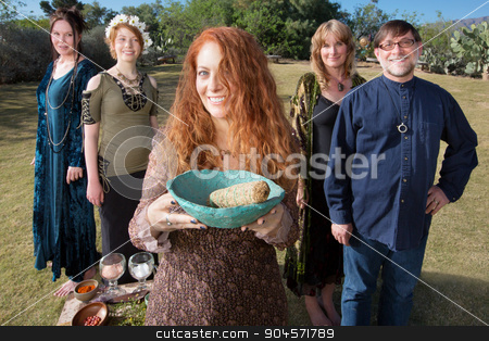 Pagan Group with Sage Smudge stock photo, Smiling woman with bowl and sage incense and friends by Scott Griessel