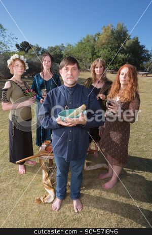 Barefoot Pagans Priest Outdoors stock photo, Barefoot pagans in ritual standing outdoors with objects by Scott Griessel