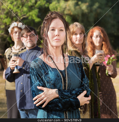 Beautiful Modern Witch stock photo, Beautiful modern witch with others in group outdoors by Scott Griessel