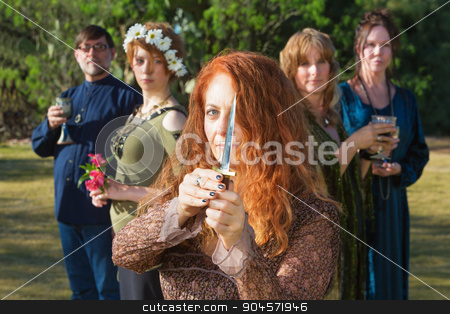 Female Pagan with Athame Outdoors stock photo, Modern pagan woman standing outdoors with ritual knife by Scott Griessel