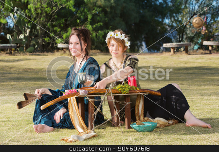 Beautiful Pagan Women at Altar stock photo, Pair of beautiful pagan women at outdoor altar by Scott Griessel