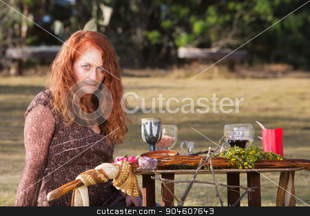 Female Wicca Practioner  stock photo, Female Wicca priestess with staff and goblets on altar by Scott Griessel