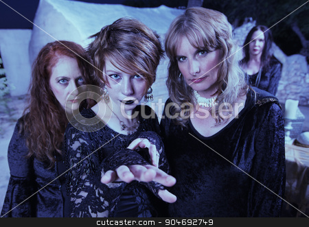 Three of Witches Outdoors stock photo, Three pretty witches in black standing outdoors near temple by Scott Griessel