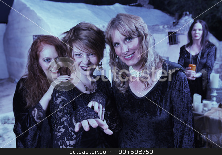 Trio of Modern Witches stock photo, Trio of beautiful witches in black standing outdoors by Scott Griessel