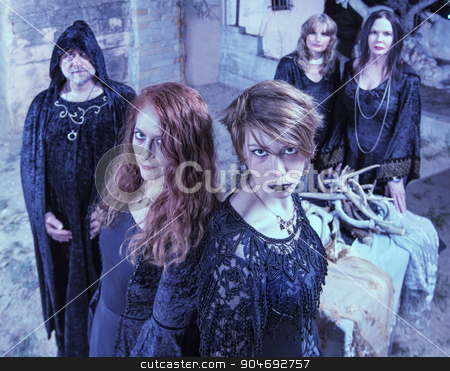 Five Satanic Worshippers stock photo, Group of five Satan worshippers near altar outdoors by Scott Griessel