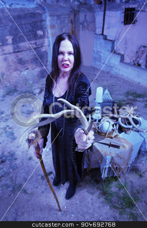 Cursing Witch with Antlers stock photo, Cursing witch with animal fetish object near altar by Scott Griessel