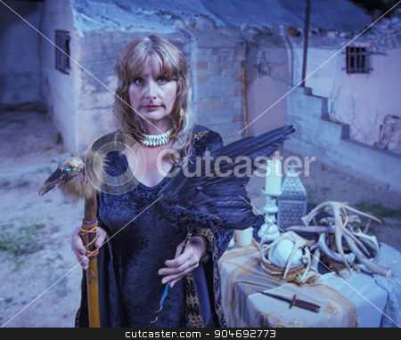 Serious Witch with Bird Fetishes stock photo, Serious female witch with altar and fetishes by Scott Griessel